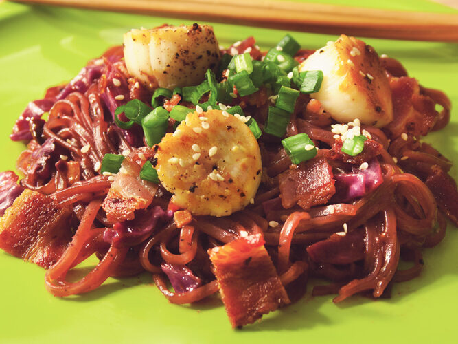 Purple corn and rice noodles with red cabbage kimchi, bacon, scallops, scallion, and sesame